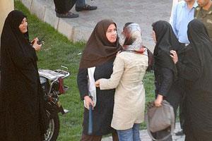 Photo: Women defy police enforcing dress code in Iran